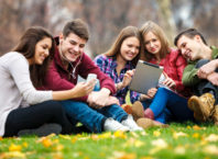 Group of young people using digital tablet and smart phone